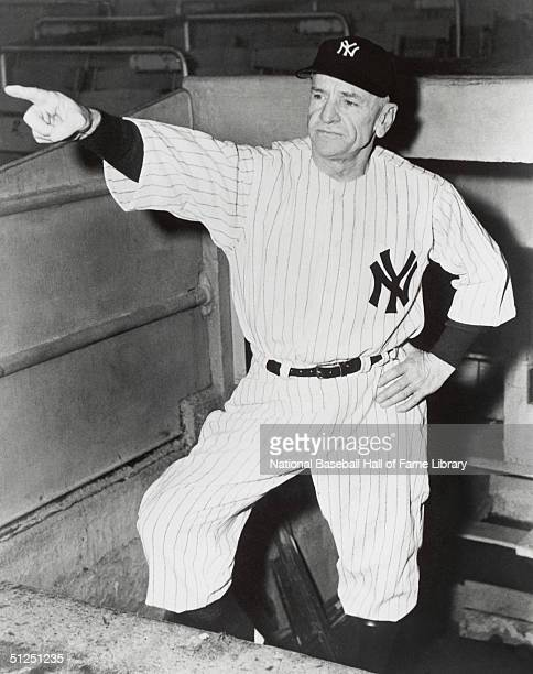 Manager Casey Stengel of the New York Yankees poses in the dugout Casey Stengel managed for the New York Yankees from 19491960