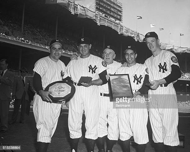 Manager Casey Stengel poses with four of his world champion New York Yankees who were honored for their 1951 performances From left are catcher Yogi...