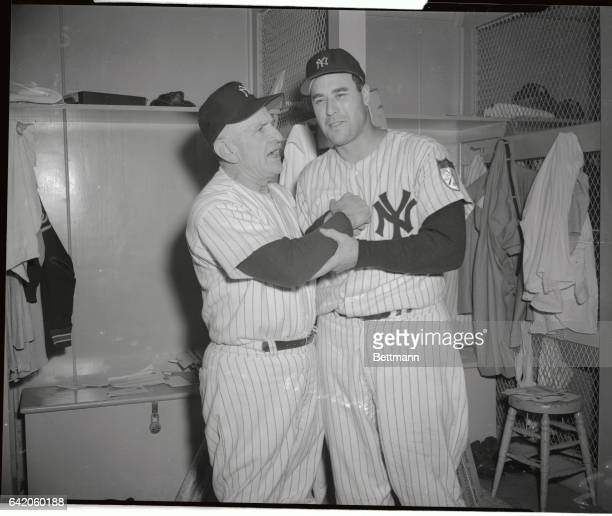 Manager Casey Stengel shakes the hand that sewed up the Yankees third straight American League pennant as he congratulates hurler Vic Raschi for his...