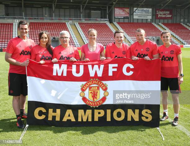 Manager Casey Stoney and her coaching staff of Manchester United Women celebrate winning the League after the WSL match between Manchester United...
