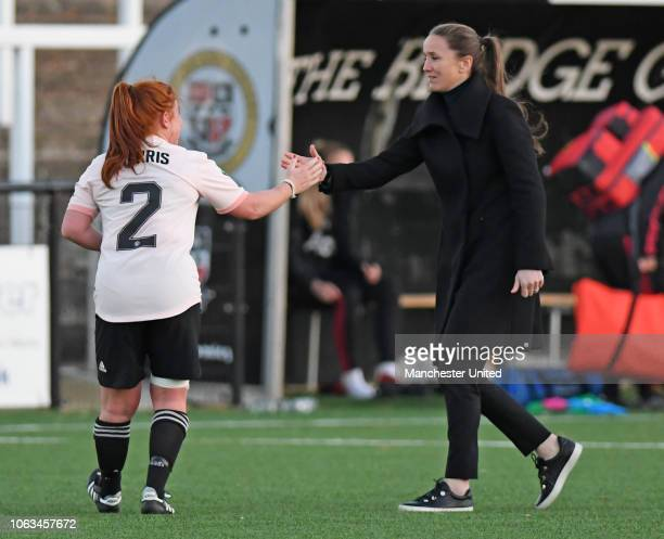Manager Casey Stoney and Martha Harris of Manchester United women celebrate after the FA Women's Championship match between Crystal Palace and...