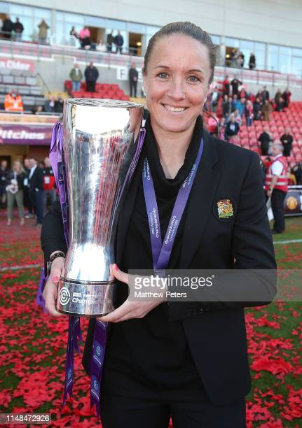 Manager Casey Stoney of Manchester United Women poses with the FA Women's Championship trophy after the WSL match between Manchester United Women and...
