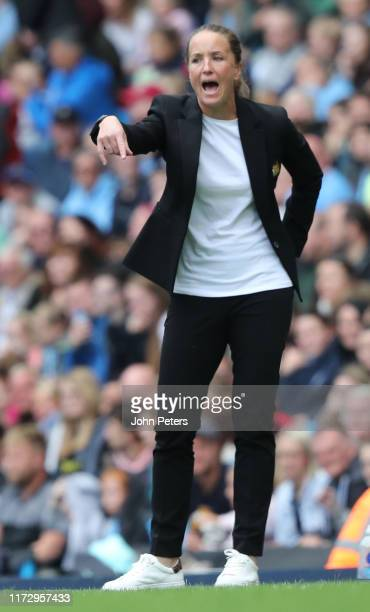 Manager Casey Stoney of Manchester United Women watches from the touchline during the Barclays FA Women's Super League match between Manchester City...