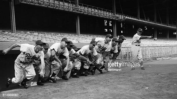 Manager Charlie Dressen of the Brooklyn Dodgers sounds the battle cry for his starting lineup in the 1952 World Series against the New York Yankees...
