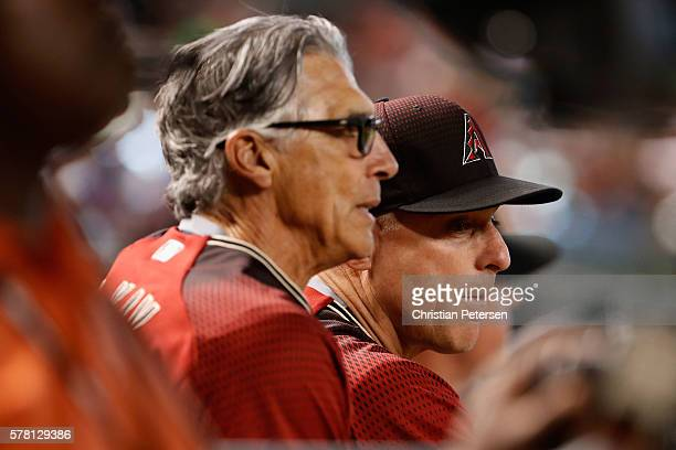 Manager Chip Hale and first base coach Dave McKay of the Arizona Diamondbacks watch from the dugout during the ninth inning of the interleague MLB...