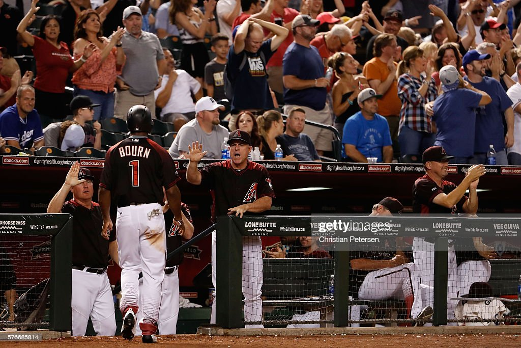 Manager Chip Hale #3 of the Arizona Diamondbacks high fives Michael Bourn #1 after scoring against the Los Angeles Dodgers during the ninth inning of the MLB game at Chase Field on August 16, 2016 in Phoenix, Arizona. The Diamondbacks defeated the Dodgers 2-1.