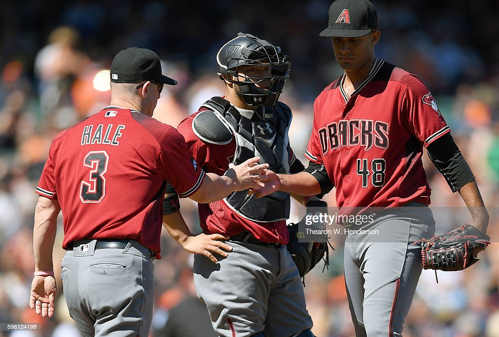 Manager Chip Hale #3 of the Arizona Diamondbacks takes the ball from pitcher Randall Delgado #48 taking him out of the game in the bottom of the seventh inning at AT&T Park on August 31, 2016 in San Francisco, California.