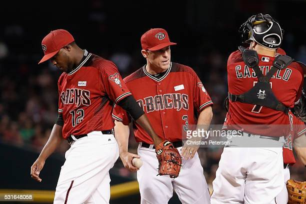 Manager Chip Hale of the Arizona Diamondbacks takes the baseball from starting pitcher Rubby De La Rosa as he is removed during the seventh inning of...
