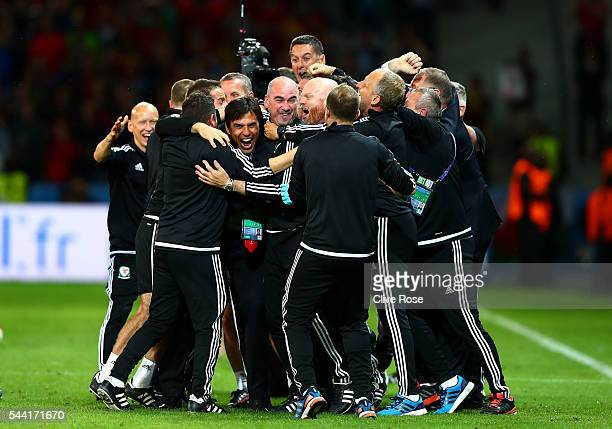 Manager Chris Coleman and Wales team staffs celebrate their team's 31 win after the UEFA EURO 2016 quarter final match between Wales and Belgium at...