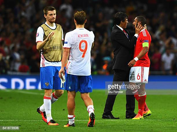 Manager Chris Coleman congratulates Ashley Williams of Wales after their 30 win in the UEFA EURO 2016 Group B match between Russia and Wales at...