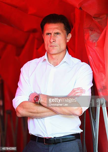 Manager Chris Hargreaves of Torquay United watches his players warm up from the tunnel during the FA Cup Qualifying Fourth Round match bteween...