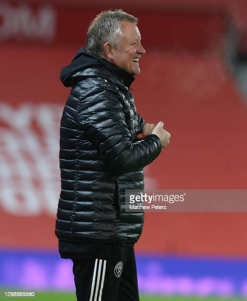 Manager Chris Wilder of Sheffield United watches from the dugout during the Premier League match between Manchester United and Sheffield United at...