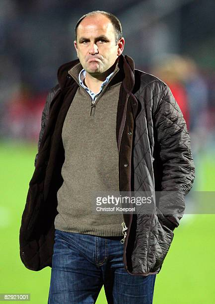 Manager Christian Hochstaetter of Hannover walks off the pitch dejected after loosing 04 the Bundesliga match between Bayer Leverkusen and Hannover...