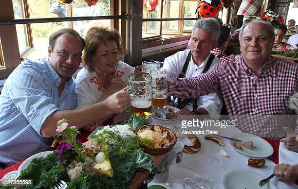 Manager Christian Nerlinger team coach Jupp Heynckes and his wife Iris and president Uli Hoeness of FC Bayern Muenchen attend the Oktoberfest beer...