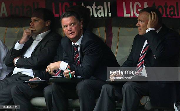 Manager Christian Nerlinger team coach Louis van Gaal and assistent coach Hermann Gerland of Muenchen attend the Bundesliga first league match...