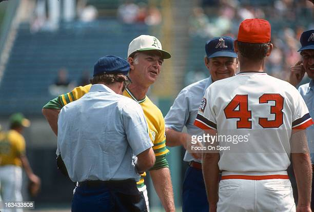 Manager Chuck Tanner of the Oakland Athletics out to exchange line up's with coach Jerry Zimmerman of the Minnesota Twins before the start of a Major...