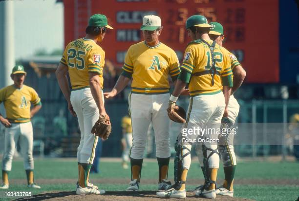 Manager Chuck Tanner of the Oakland Athletics stands on the pitchers mound talking with his pitcher Paul Lindblad and catchers Larry Haney during a...
