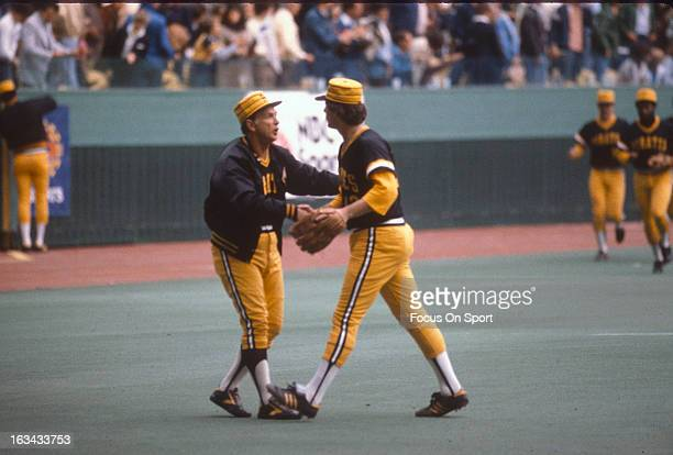 Manager Chuck Tanner of the Pittsburgh Pirates congratulates winning pitcher Don Robinson after a victor in a Major League Baseball game circa 1980...