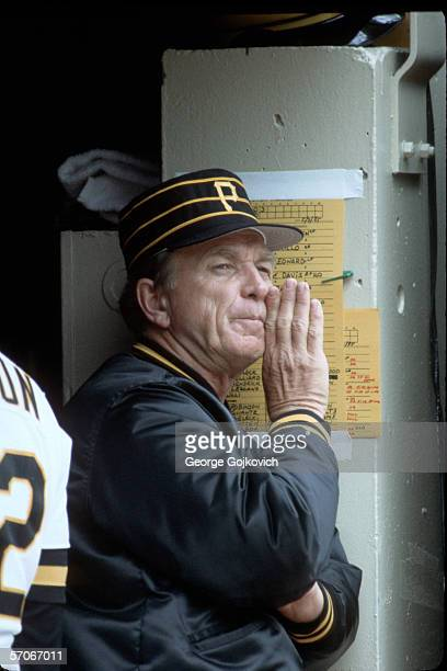 Manager Chuck Tanner of the Pittsburgh Pirates signals to players from the dugout during a game against the San Francisco Giants at Three Rivers...