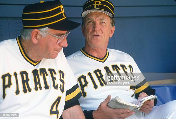 Manager Chuck Tanner of the Pittsburgh Pirates talks with one of his coaches sitting in the dugout during an Major League Baseball game circa 1981 at...