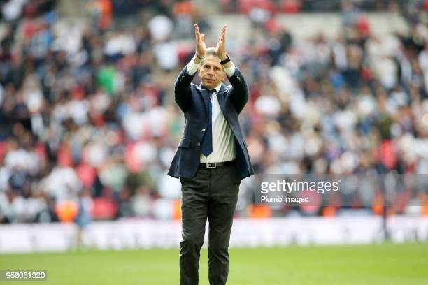 Manager Claude Puel of Leicester City applauds the travelling fans after the Premier League match between Tottenham Hotspur and Leicester City at...