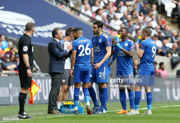 Manager Claude Puel of Leicester City gives instructions to his players during a break in play of the Premier League match between Tottenham Hotspur...
