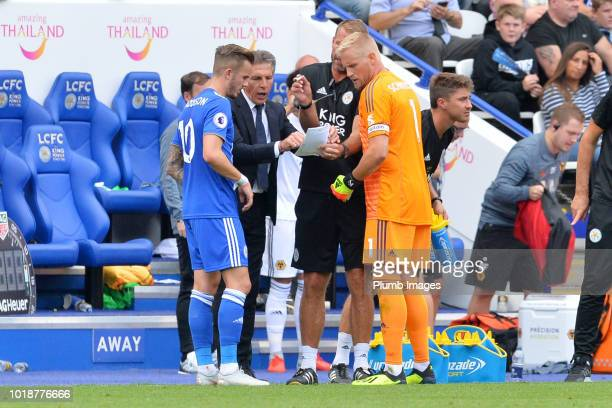Manager Claude Puel of Leicester City gives instructions to James Maddison and Kasper Schmeichel of Leicester City during the Premier League match...