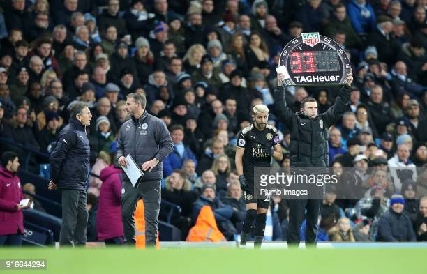 Manager Claude Puel of Leicester City prepares to bring on Riyad Mahrez of Leicester during the Premier League match between Manchester City and...