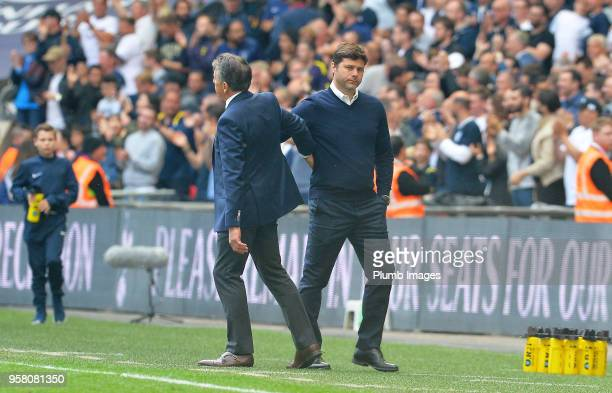 Manager Claude Puel of Leicester City with Manager Mauricio Pochettino of Tottenham Hotspur after the Premier League match between Tottenham Hotspur...