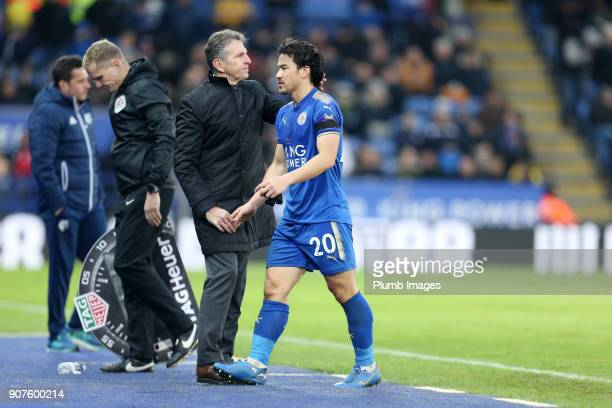Manager Claude Puel of Leicester City with Shinji Okazaki of Leicester City after he is substituted during the Premier League match between Leicester...