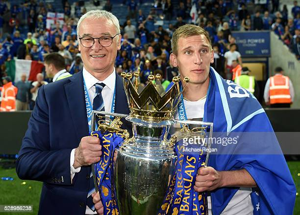 Manager Claudio Ranieri and Marc Albrighton of Leicester City the Premier League Trophy as players and staffs celebrate the season champion after the...