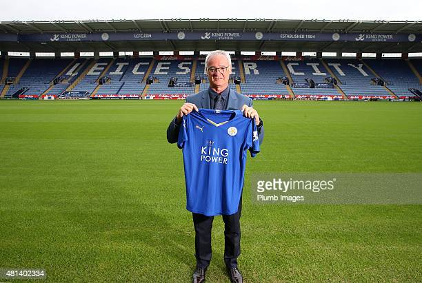 Manager Claudio Ranieri of Leicester City poses on the pitch with their football shirt during a Leicester City training session and press conference...