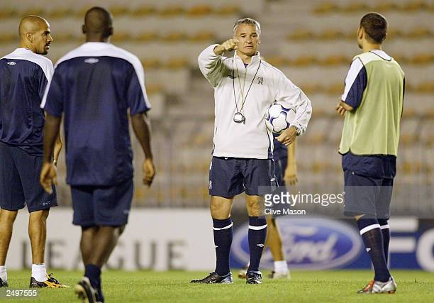 Manager Claudio Ranieri talks to his players during the Chelsea training session at the Letna Stadium on September 15 2003 in Prague Czech Republic...