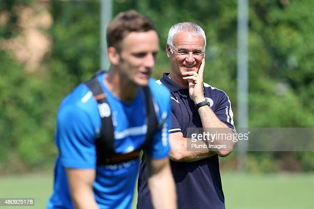 Manager Claudio Ranieri watches Andy King of Leicester City during a training session at their preseason training camp on July 16 2015 in Bad...