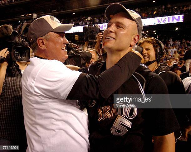Manager Clint Hurdle and Matt Holliday of the Colorado Rockies celebrate their wild card playoff baseball victory over the San Diego Padres on...