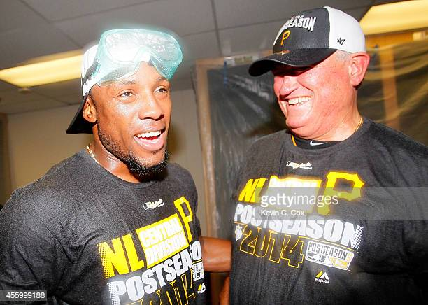 Manager Clint Hurdle and Starling Marte of the Pittsburgh Pirates celebrate clinching a National League playoff spot after their 32 win over the...