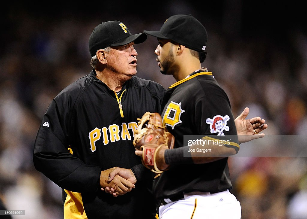 Manager Clint Hurdle celebrates with Pedro Alvarez #24 of the Pittsburgh Pirates after a 2-1 win over the Chicago Cubs on September 14, 2013 at PNC Park in Pittsburgh, Pennsylvania.