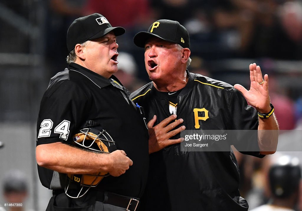 Manager Clint Hurdle of the Pittsburgh Pirates argues with home plate umpire Jerry Layne #24 after being ejected during the sixth inning against the St. Louis Cardinals at PNC Park on July 14, 2017 in Pittsburgh, Pennsylvania.