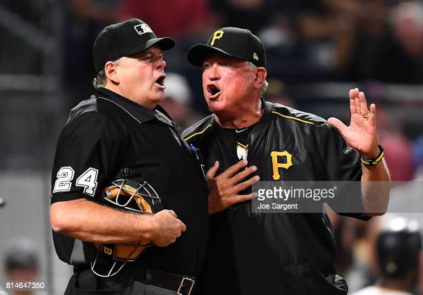 Manager Clint Hurdle of the Pittsburgh Pirates argues with home plate umpire Jerry Layne after being ejected during the sixth inning against the St...