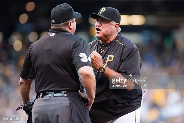 Manager Clint Hurdle of the Pittsburgh Pirates argues with umpire Sam Holbrook after being ejected in the first inning during the game between the...