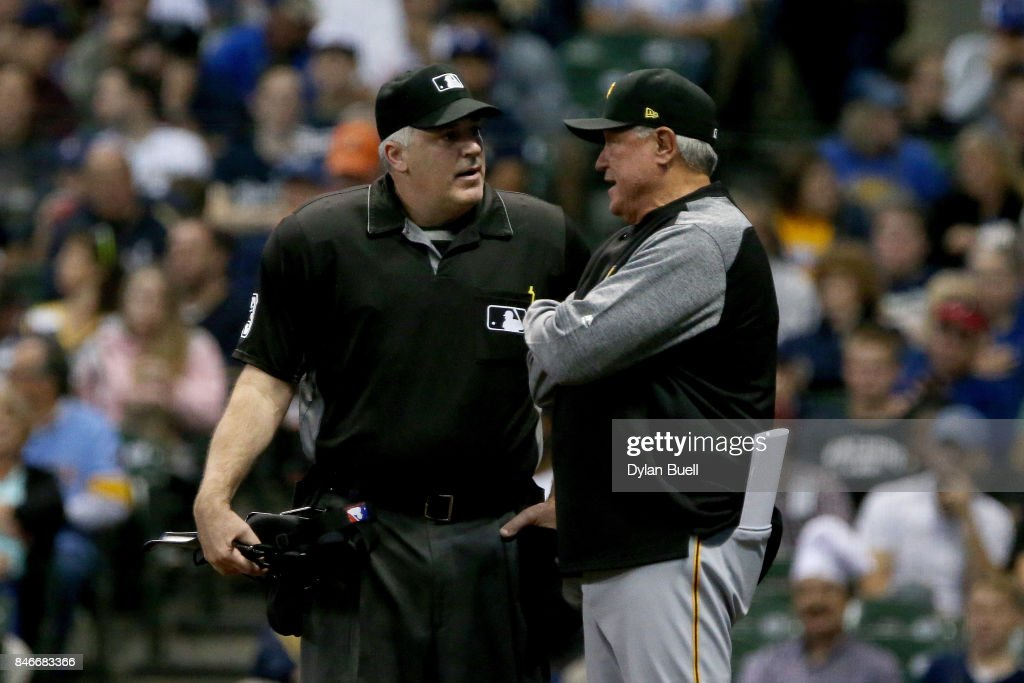 Manager Clint Hurdle of the Pittsburgh Pirates argues with umpire Tim Welke in the first inning against the Milwaukee Brewers at Miller Park on September 13, 2017 in Milwaukee, Wisconsin.