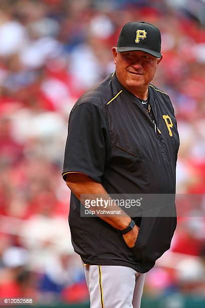 Manager Clint Hurdle of the Pittsburgh Pirates checks on a player during an atbat against the St Louis Cardinals in the third inning at Busch Stadium...