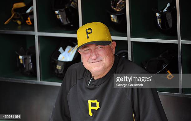 Manager Clint Hurdle of the Pittsburgh Pirates looks on from the dugout before a game against the Philadelphia Phillies at PNC Park on July 6 2014 in...