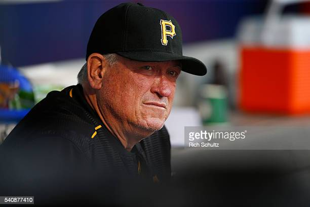 Manager Clint Hurdle of the Pittsburgh Pirates looks on from the dugout during a game against the New York Mets at Citi Field on June 15 2016 in the...