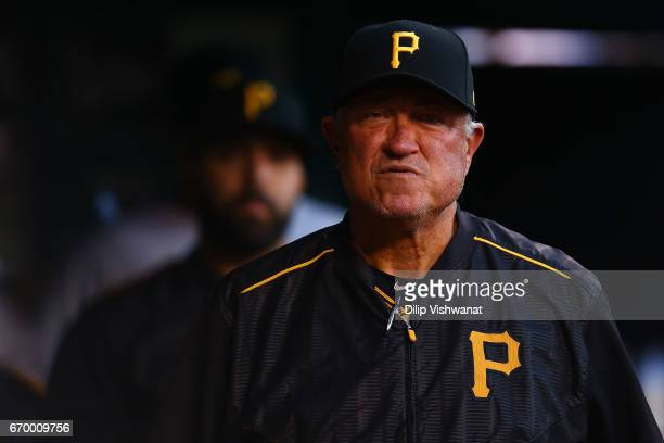 Manager Clint Hurdle of the Pittsburgh Pirates looks on from the dugout during ag game against the St Louis Cardinals at Busch Stadium on April 18...