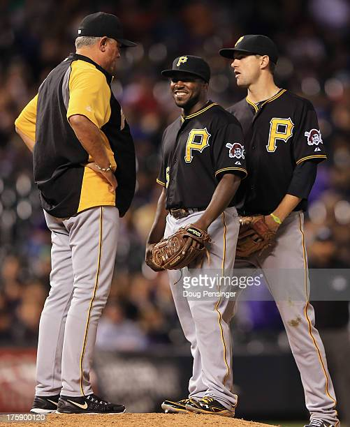 Manager Clint Hurdle of the Pittsburgh Pirates puts infielder Josh Harrison of the Pittsburgh Pirates into the game to pitch against pinch hitter...
