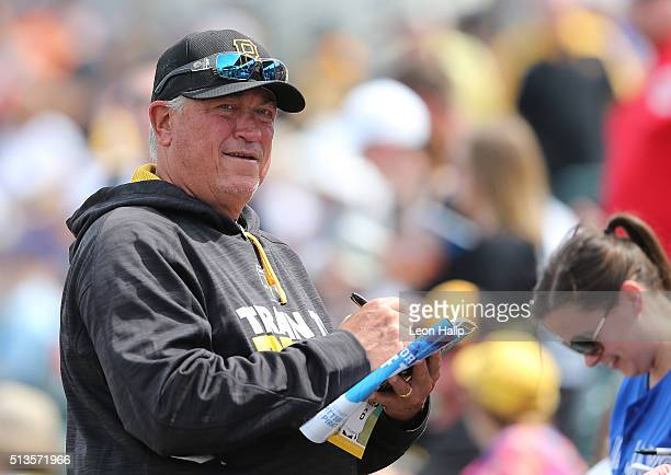 Manager Clint Hurdle of the Pittsburgh Pirates signs autographs prior to the start of the Spring Training Game against the Toronto Blue Jays on March...