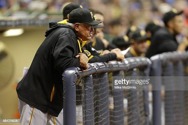 Manager Clint Hurdle of the Pittsburgh Pirates watches the game from the edge of the dugout during the fourth inning against the Milwaukee Brewers...