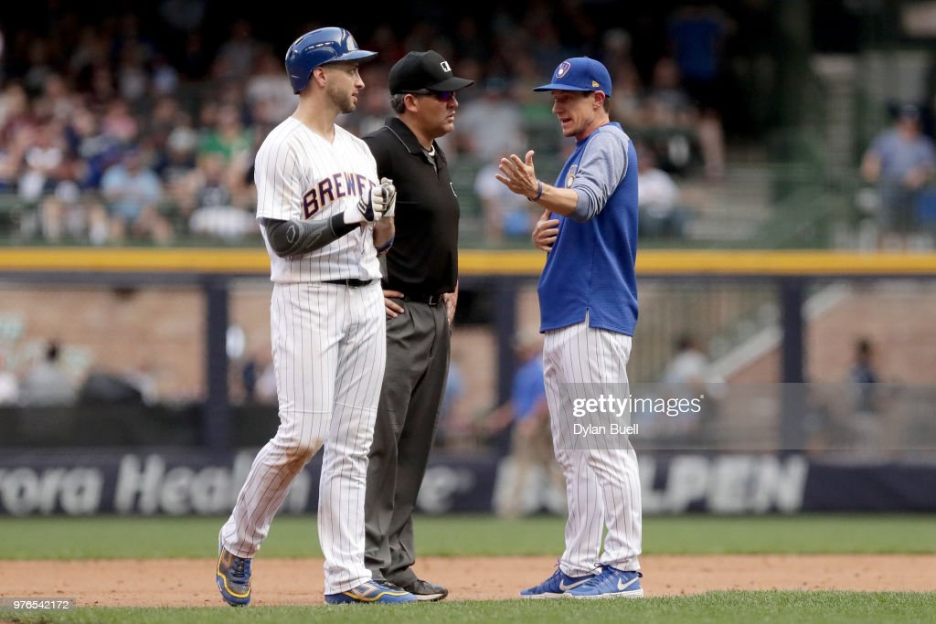 Manager Craig Counsell of the Milwaukee Brewers argues a call with umpire Manny Gonzalez after Ryan Braun #8 was called out in the seventh inning against the Philadelphia Phillies at Miller Park on June 16, 2018 in Milwaukee, Wisconsin.