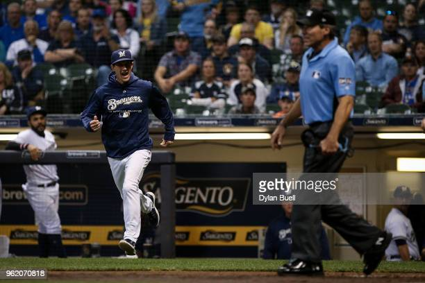 Manager Craig Counsell of the Milwaukee Brewers argues with umpire Angel Hernandez in the ninth inning against the Arizona Diamondbacks at Miller...
